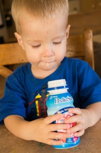 kid is drinking pediasure
